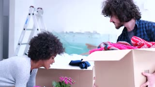 Attractive Couple Moving Boxes Into Their Living Room