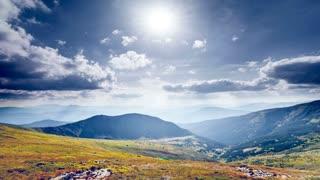 Beautiful autumn mountain panorama. Clouds floating in blue sunny sky. Exploring beauty world: Carpathians, Ukraine, Europe. Travel, hiking, holidays, recreation. Nature landscape Slow motion 4K