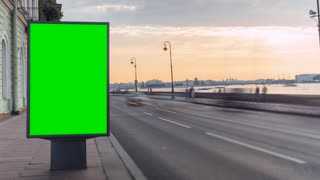 Billboard With a Green Screen on the Busy Roadway