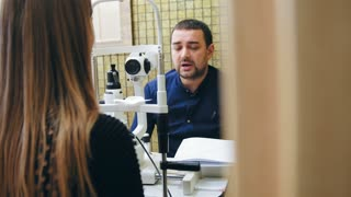 Blonde female in optometrist's room - ophthalmology doctor - checking female's Eyesight