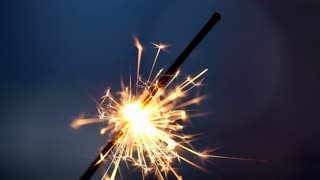 Burning Sparkler On Blue Background Sparkling Firework Burns