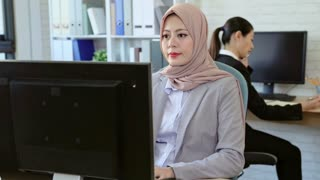 Team of smart businesswomen working on computers in China