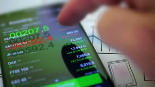 Businessman checking stock market data on smartphone. 4K UHD video.