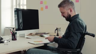 Businessman in wheelchair working in the office