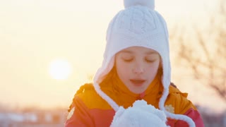 Child Girl 8 Years Old Blowing Snowflakes Outdoors In Sunset Slow Motion From Sony A 6300