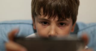 Child Playing With Smartphone Technology Close Up Of Young Boy Playing Video Game In 4K