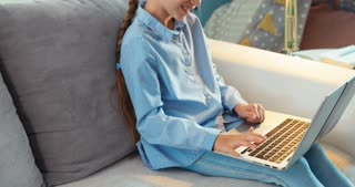 Child Using Laptop In Living Room