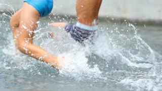 Children Splashing And Jumping Inside Swimming Pool Water In 120 Fps Slow Motion