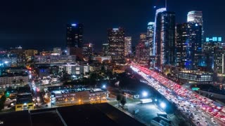 Cinematic 4K urban aerial timelapse of downtown Los Angeles freeway with rush hour traffic