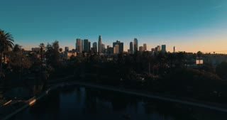 Cinematic aerial drone footage of downtown urban Los Angeles from Echo Park with city skyline, freeway and traffic below