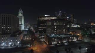 Cinematic urban aerial of downtown Los Angeles skyscrapers in 4K at night