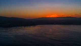 Cinematic urban aerial timelapse in motion or hyperlapse during morning sunrise in Laguna Beach