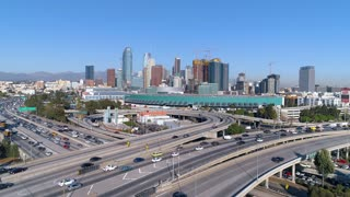Cinematic urban aerial view of downtown Los Angeles, freeway, interstate and L.A. convention center as seen from the interstate.