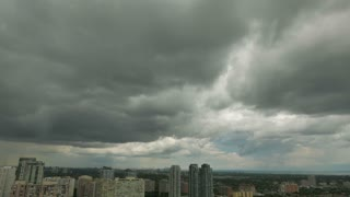 City Storm Rain Passing Through. Storm clouds and rain passing through Mississauga, Ontario, Canada.