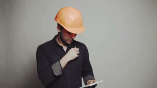 Civil construction worker, builder, architect on gray background