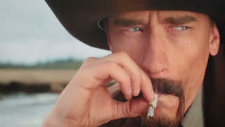 Close Up of Cowboy Smoking