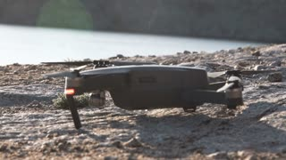 Close view of the takeoff drone which start to fly from rock