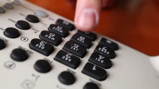 Closeup Of Office Phone Dials Person Calling By Placing Number