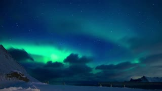 Clouds and Northern Lights in the Night Sky of Lofoten. Time Lapse