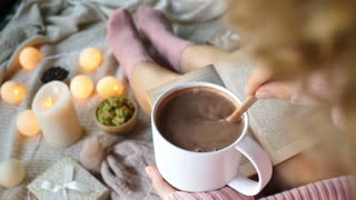 Cozy Woman With Cacao Cup Reading Book At Home At Christmas
