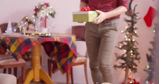 Daughter opens up present given by her Dad, she is surprised when she sees what she got. Slow Motion.