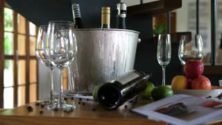 Decoration In Restaurant With Wine In Bucket And Glasses On Table
