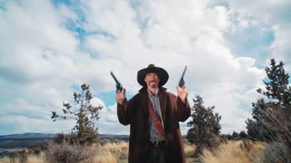 Dolly Shot of Cowboy Walking Towards Camera With Guns