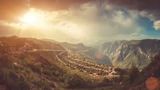 Dramatic aerial mountain village view. Colorful cloudy sunset sky motion. Explore beauty world: Armenia. Travel, hiking, holidays, recreation. Nature landscape. Vintage warm toning. Slow motion 4K