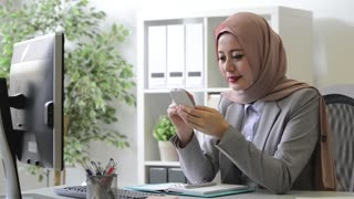 elegant beauty muslim woman texting message