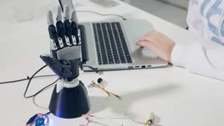 Engineer set up innovative bionic robotic arm