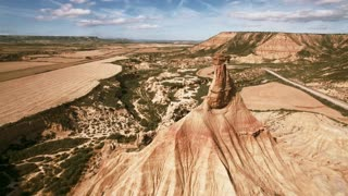 Epic drone footage of natural wonder of spain south desert, rock sand geological formations created by errosion, wind and earth powers, sunny summer day with mountains