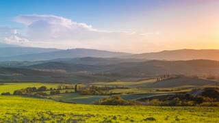 Evening over the Fields and Hills of Tuscany. Time Lapse