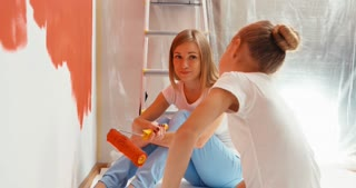 Family Painting Wall To Red