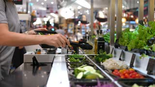 Female Customer Choosing Salad At Salad Bar In Supermarket