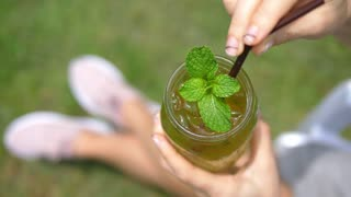Female Hands Holding Summer Fresh Drink with Mint