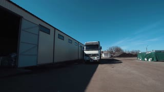 Front view of the manager leading the truck arrival to the warehouse