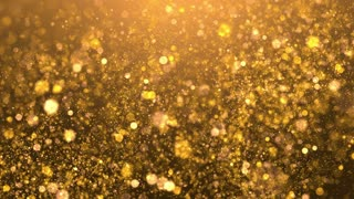 Glittering golden sparks flying in a blurred background. 4K UHD video loop animation.