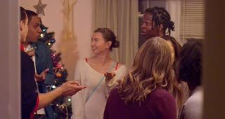 Group of friends laughing and having a good time at Christmas party. Slow motion.