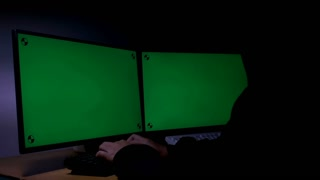 Hacker Using Computer Green Screen With Tracking Marker 002