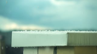 Hailstones hitting metal roof. Super slow motion shot