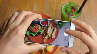 Hands Taking Pictures Of Food Vegan Burger And French Fries In Cafe