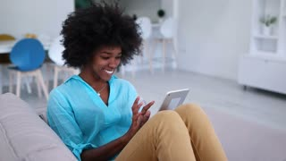 Happy Afro American Woman With Tablet Pc At Home