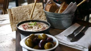 Healthy Hummus With Olives And Fresh Pita Bread