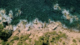 High definition with copy space shot of aerial drone image of coastline of ocean or mediterranean sea. waves crush on rocks and cliffs, amazing summer destination, inspiration for trip