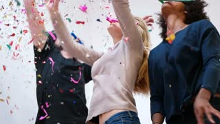Hipster Friends Partying And Playing With Confetti