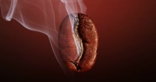 hot coffee bean smoked in a deep dark background