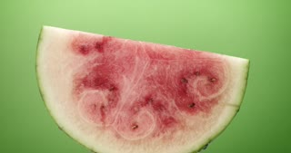 invisible being person eats a water-melon slice