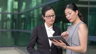 Japanese business colleagues discuss plan