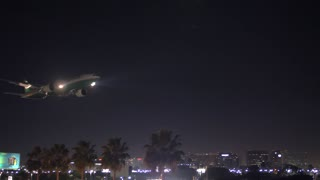 Jet airplane landing at LAX airport in Los Angeles in the evening.