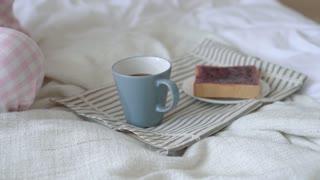 Asian woman having breakfast in bed